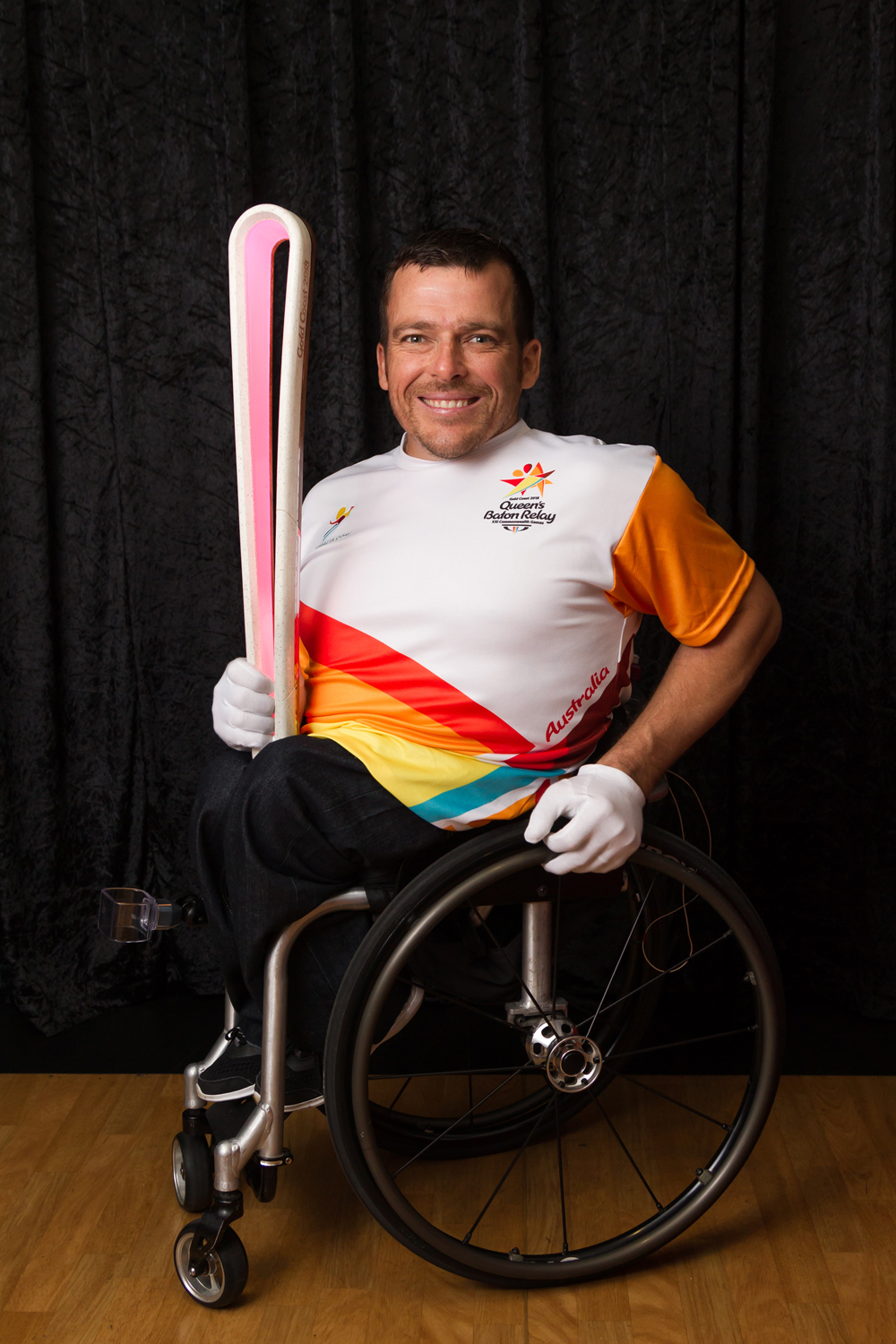 Kurt Fearnley with the Queen's Baton.
