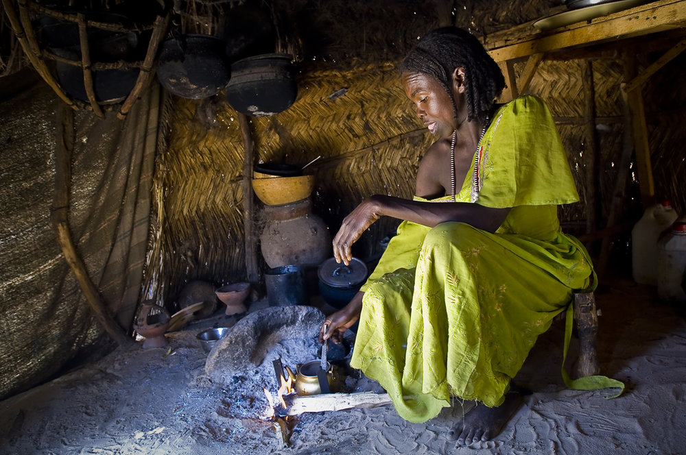 A woman prepares tea, in her kitchen, a separate hut in the family compound. Created on 4 june 2004, Djabal camp sheltered 17.766 persons and 4.681 families in december 2011. It is located 4 kilometers west from Goz Beida, 217 kilometers south from Abeche, 900 kilometers east from N'Djamena the capital and 80 kilometers from the sudanese border.