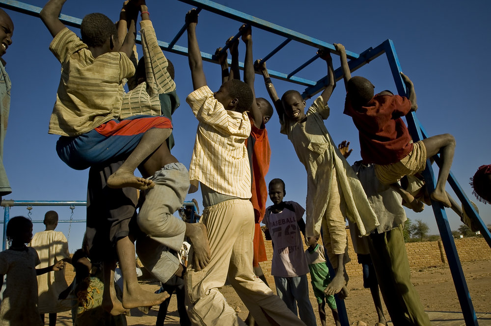 Children play at a playground equiped with some iron swings and frames. Farchana camp  (22 887 refugees on 30 september 2011), located 120 kilometers east from Abeche, 1020 kilometers east from N'Djamena the capital, 56 kilometers from the sudanese border, was opened in january 2004.