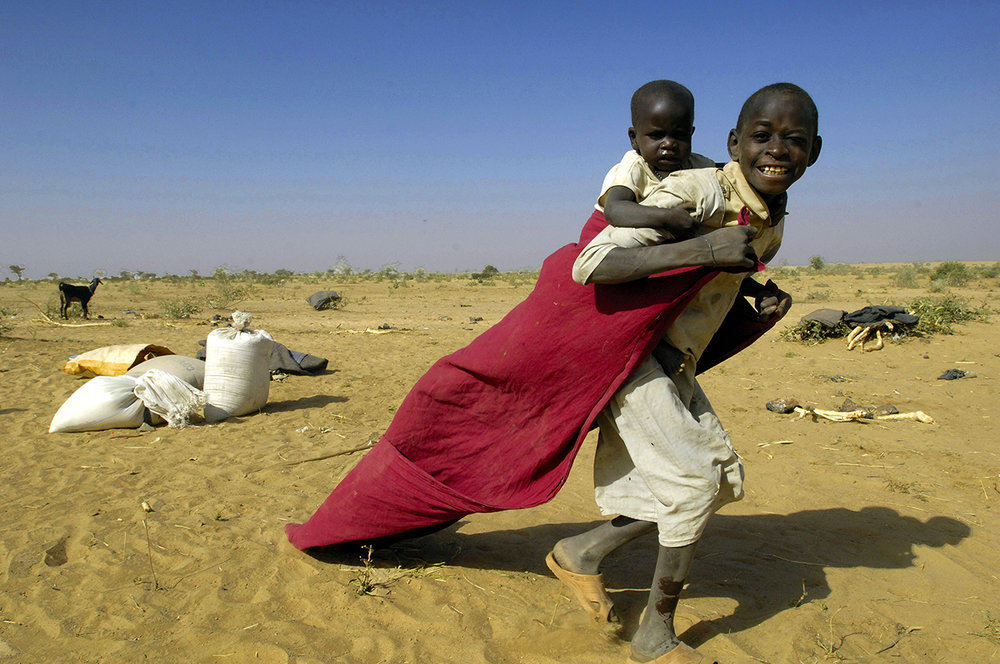 A young refugee playing with his sister in Himera area close to the sudanese border.