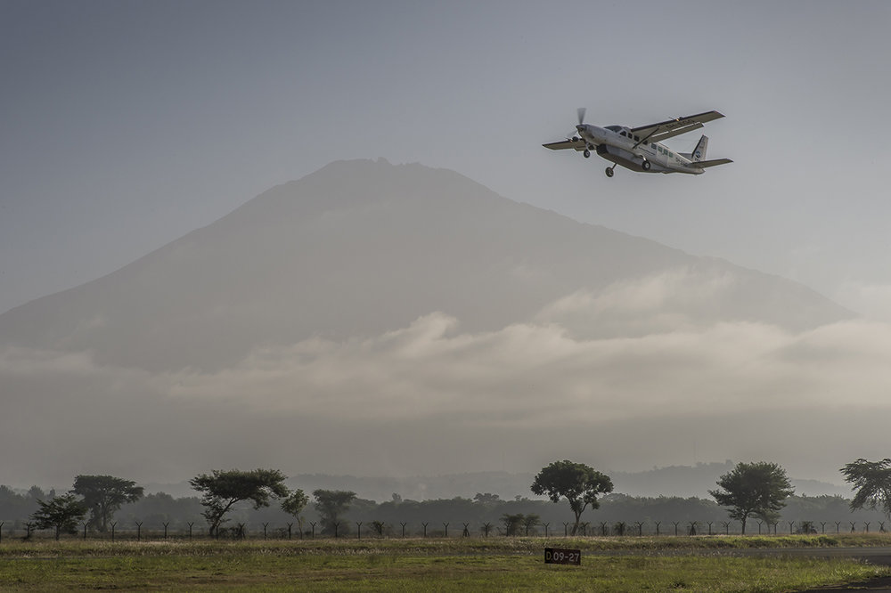 Early morning on Arusha airstrip, in northern Tanzania. A Cessna Grand Caravan belonging to a private company takes off with few tourists, for the airstrip of Seronera, an hamlet of few houses located in the heart of Seregenti National Parc, in Tanzania.