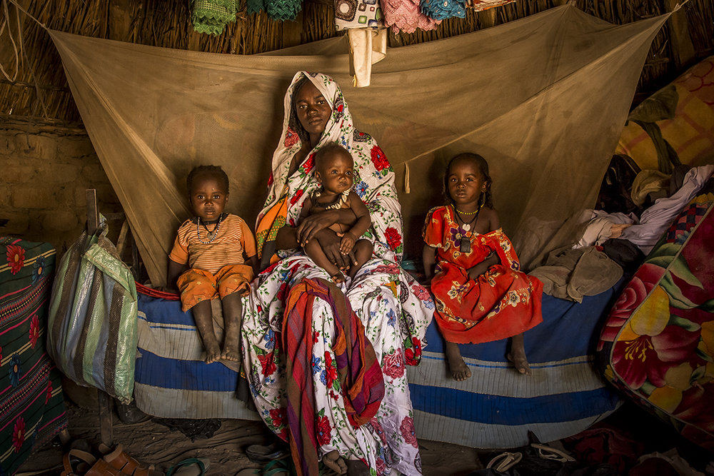 Few kilometers away from the village of Malanga, Ouara district, Houra Hassan, 27 years old and her three daughters, are sitting on the only bed in the hut. In her arms, she holds Mariam, 9 months, on the left is Adijo, 3 years and a half and Adija, 5 years on the right. The girls have successively suffer from malnutrition, during a period when Houra had difficulties to feed herself, thus to produce milk. She learnt the existence of malnutrition in the Health Center. She ignores its existence before, thinking that her daughters were « only » sick. In the future, she would liker her daughters to go to school, then to get their own plot, as she does. Presently, there is not school in the village as the parents did not manage to gather enough money to pay for a teacher.