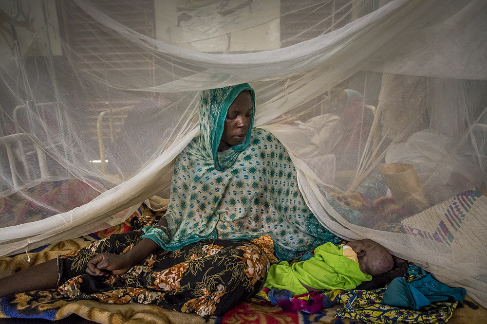 Regional hospital of Abeche, Ouara district. The mother of Rashida, 3 days, infected by pre-natal tetanus, look upon the sleep of her daughter, in a dormitory of Pediatric Section.