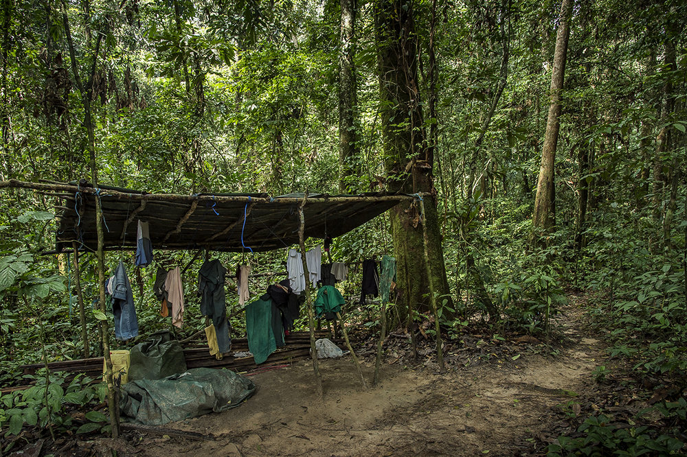 """At the entrance of """"Camp Boyé"""", an eco-camp of the Wild Chimpanzee Foundation (WCF) in the middle of the tropical forest of Taï, eco-guides tries to dry their clothes. The humidity is extremely high in the forest. Everything dries really slowly, if only it dries."""