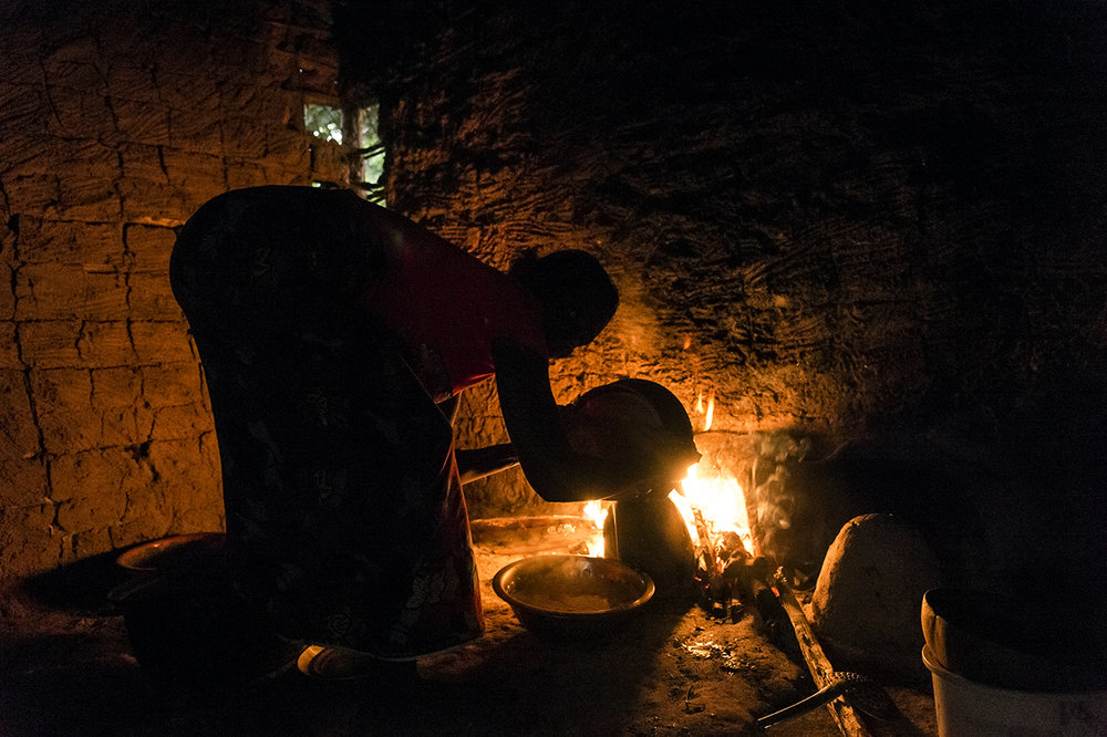 In a house in the village of Gouleako, close to the Taï National Park, a 10-minute drive from the town of Taï, a woman prepares the evening meal. Gouleako is part of an eco-tourism circuit. Visitors can spend the night there eating and hearing the history of the village during a traditional evening organized and managed by the villagers. To limit poaching and agricultural encroachment on the forest, it is essential that the local populations are integrated into the economic scheme of eco-tourism.