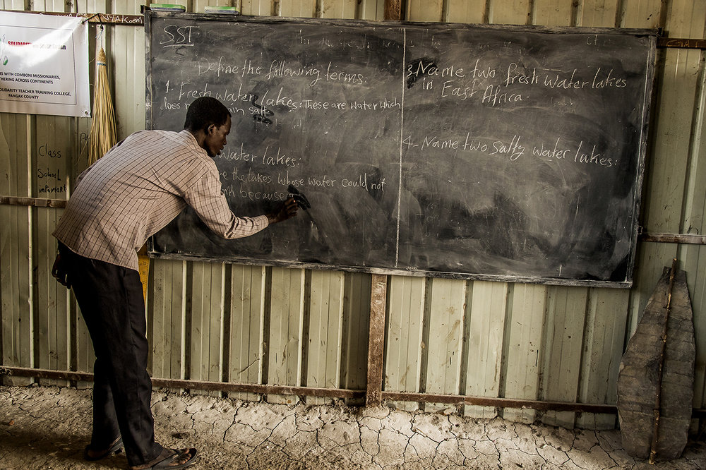 During a training of several months, given by a small American NGO (Mothering Across Continents) during school holidays, to more than 70 teachers of schools in Old Fangak County, a teacher answers on the blackboard to the questions. The training takes place in the big school of Old Fangak.