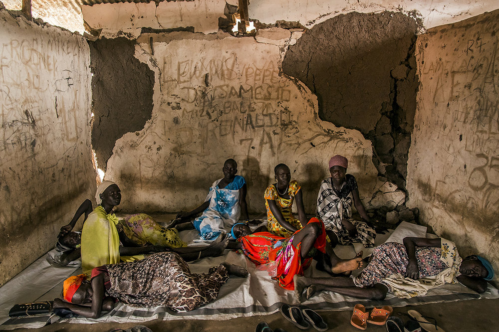 Young women gathered in a building in ruins, waiting to see the medical officer, in the village of Kier. The building est a Health facilities built by an NGO, until it left and hand over it to another NGO which does not come much in the area…
