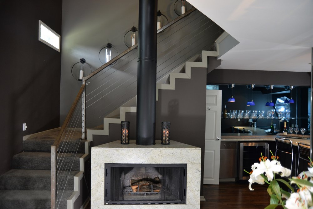 Apartment 5.3 Fireplace _ Stairs to loft.JPG