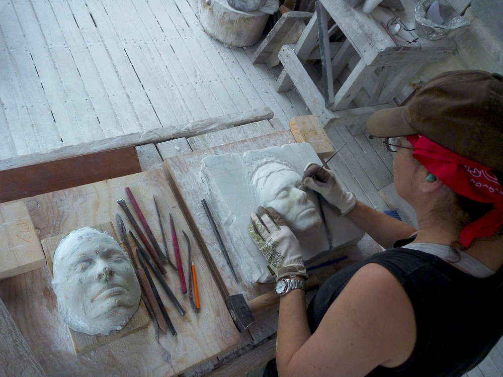 Sculptor-carving-marble-face-level-2-stone-sculpture-course.jpg