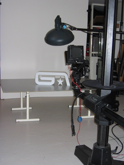 And action: the scale perspex model of the Groove Armada logo gets ready for its close up.