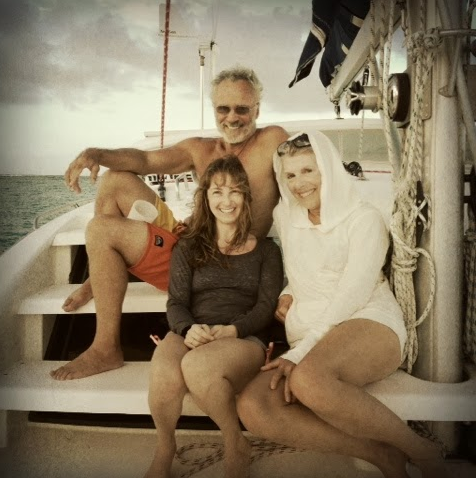 Lynne, Rose and Henry on the foredeck at Great Sandy Cay, Turks