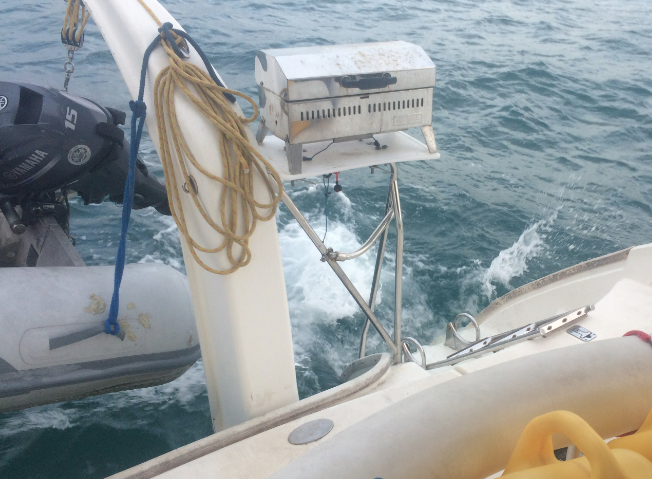 Dawning lobstermen / fishermen rev their engines, send their waves waking.