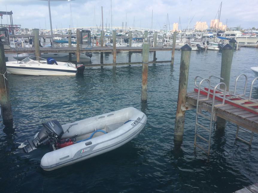 Docked on shore leave, she waits like faithful inflatable side kick.