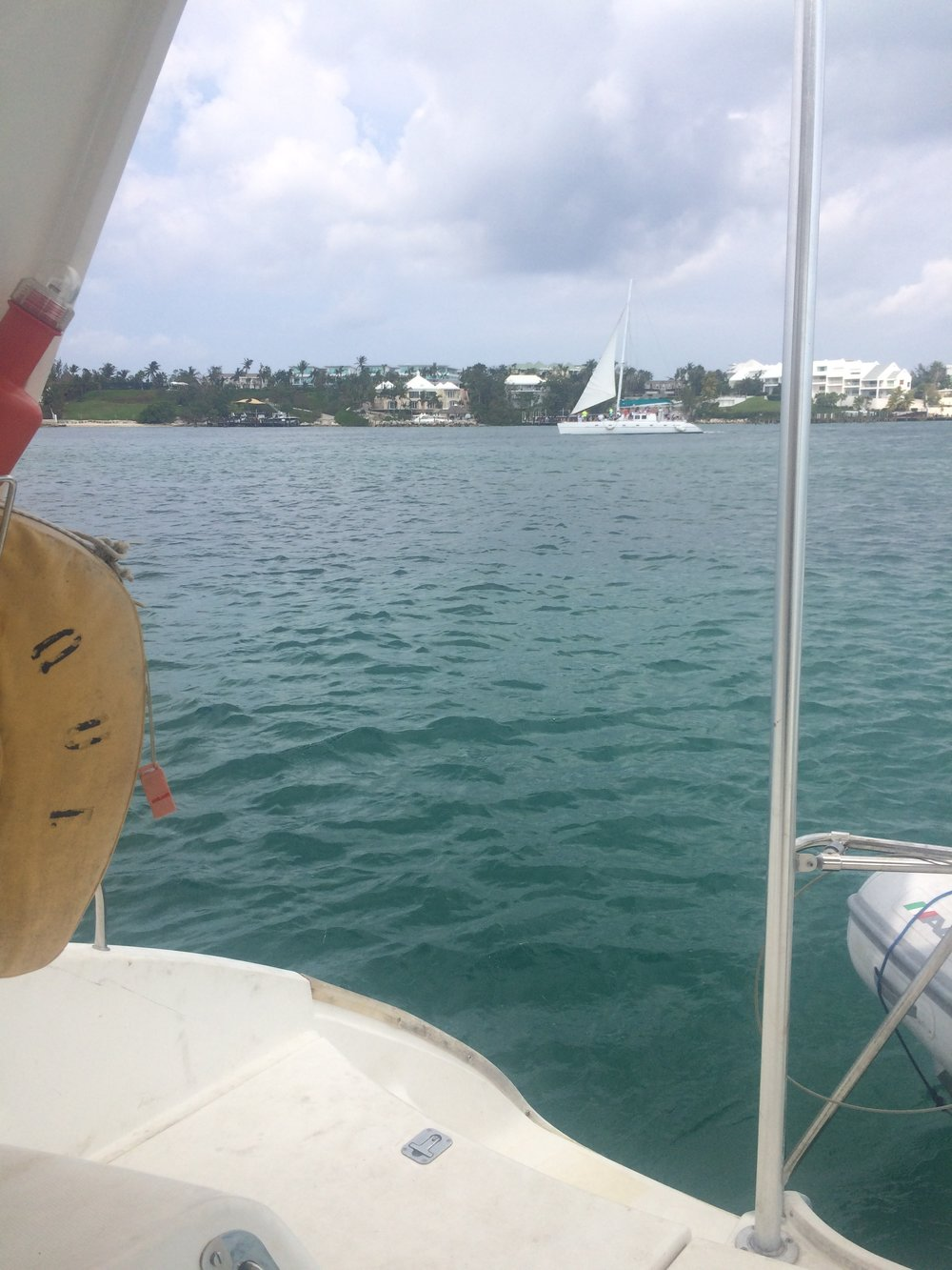 Tour boats cruise harbor narrating Bahamian bests as they pass.