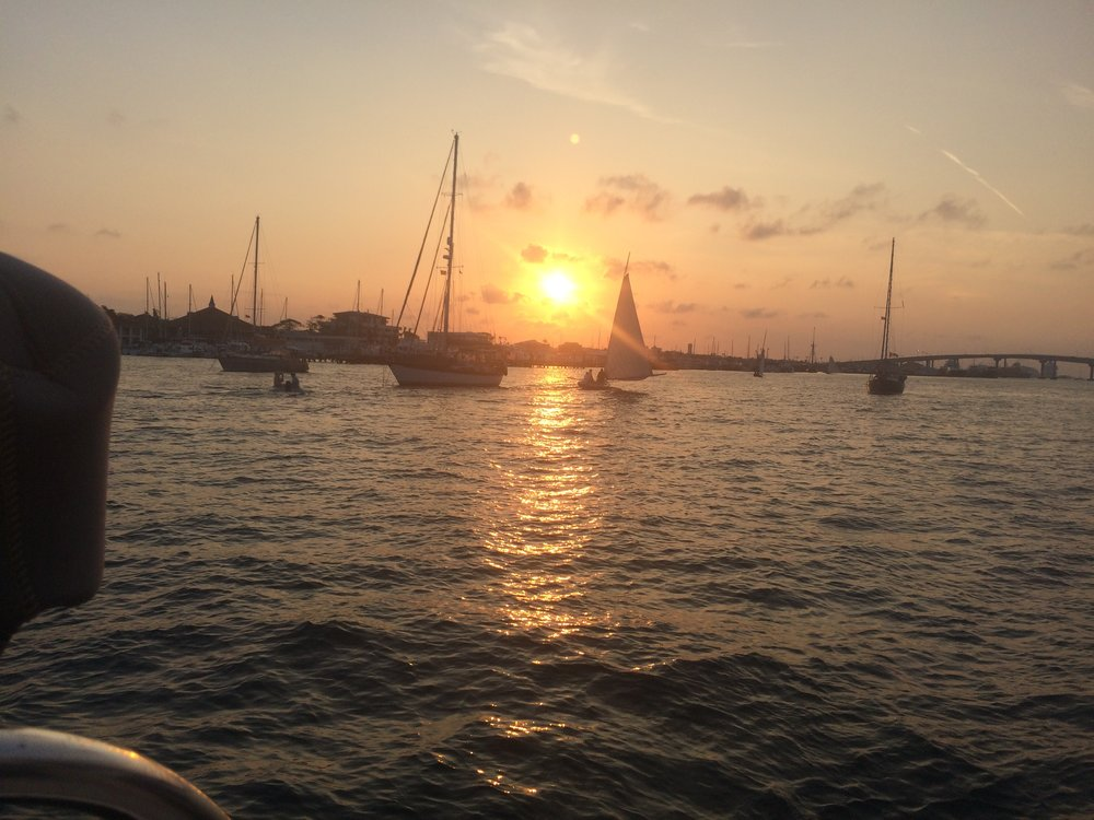 Sunset ends Sunday races for one of 5-6 Bahamian skiffs.