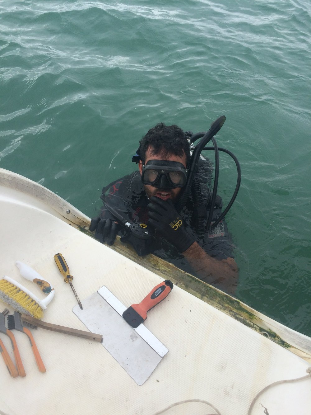 Maikel diving to fix the prop.