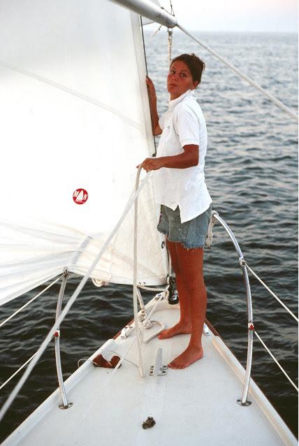 Susan Handy comforting  Nicole's  jib and ushering her saggy spinnaker sail.