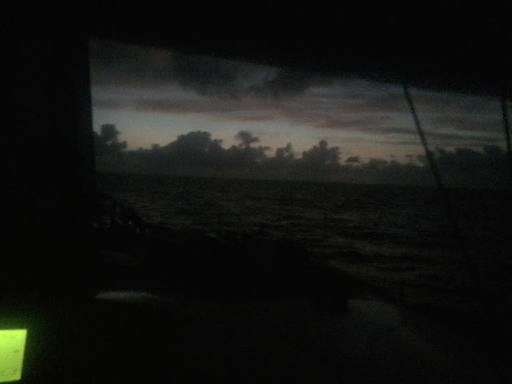 An early dawn horizon the clouds like shore trees appear upon an eastern Bahamian sky northwest of New Providence in May 2016 reminded me of how light emerges and separates dark. The green glow of my GPS screen is another light reminder.