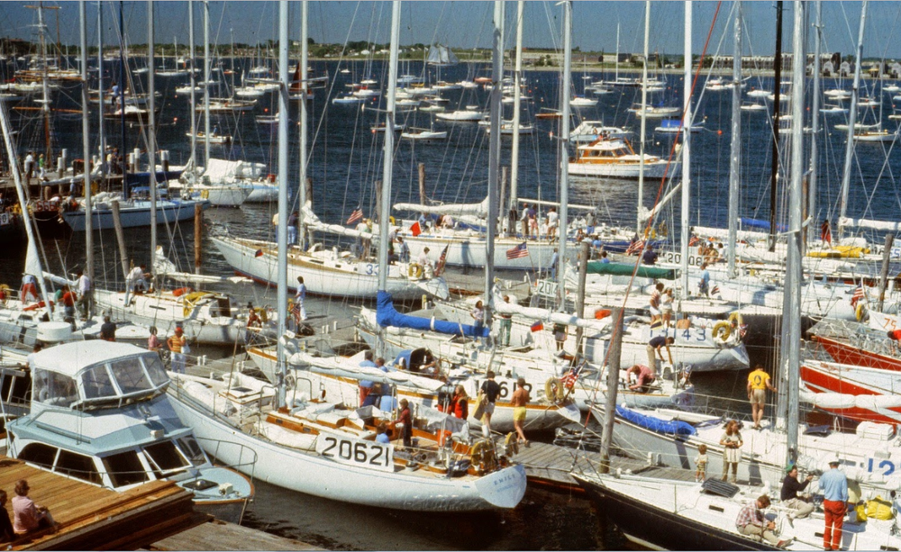 1976 Newport-Bermuda Race contestants line the Newport docks and prepare to   sail southeast while  Reindeer  sails northeast.