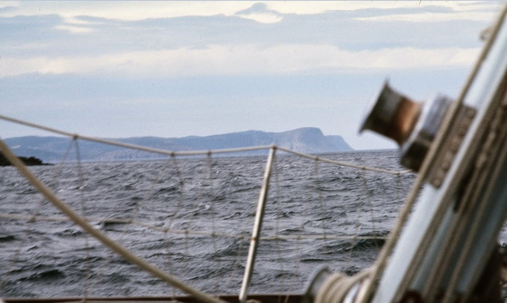 A 50-knot gust hits as we approach the last stretch of Newfoundland.  Seas are relatively calm because wind is coming from the shore.  St. John's harbor entrance is dead ahead in the distance.