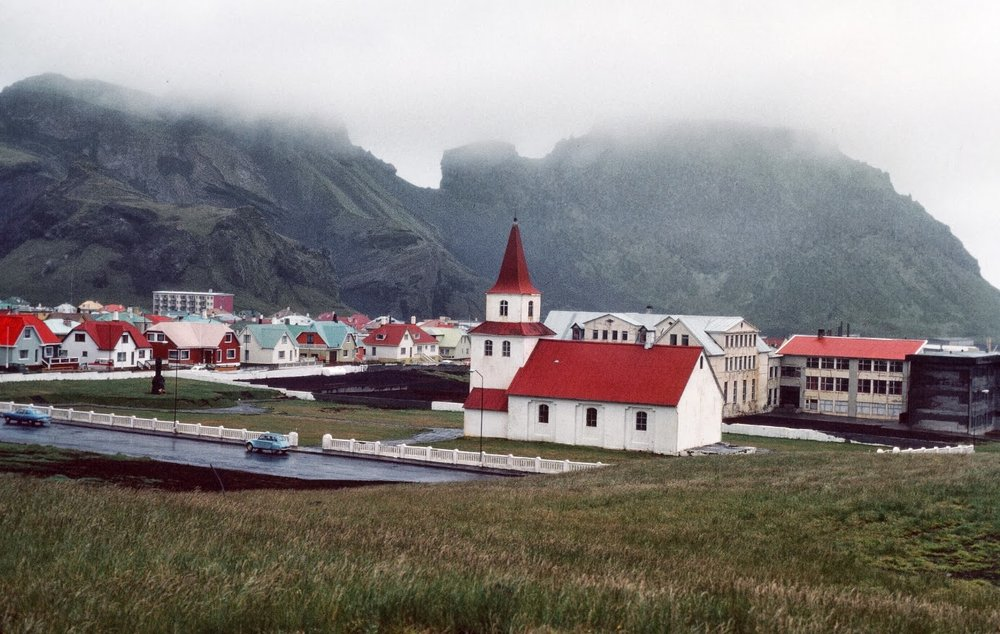 A colorfully-roofed town of 5,500 residents, all families of Icelandic fishermen.