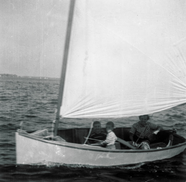 My mother at the helm of   Dormouse  , one of the Penguins my father built,with my brother Bill and me as crew hanging onto the centerboard circa 1954. My mother was always surrounded by some characters, creatures and creations