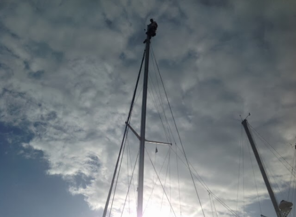 """My """"old"""" friend Clint (62) atop    Mystique's    62' 4"""" mast last December in the Turk and Caicos."""