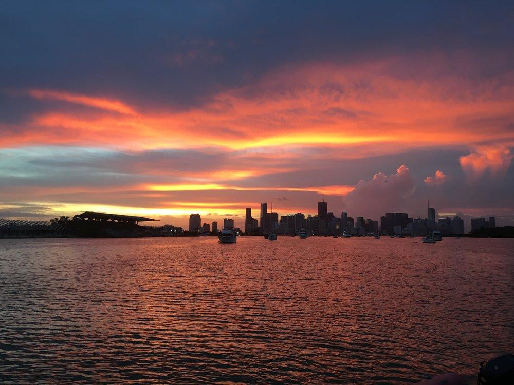 Night sky over Miami precedes a delightful day.