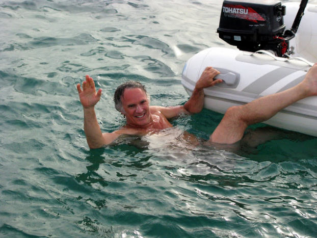 Immersed in St Maarten's waters as I hold onto my dinghy.