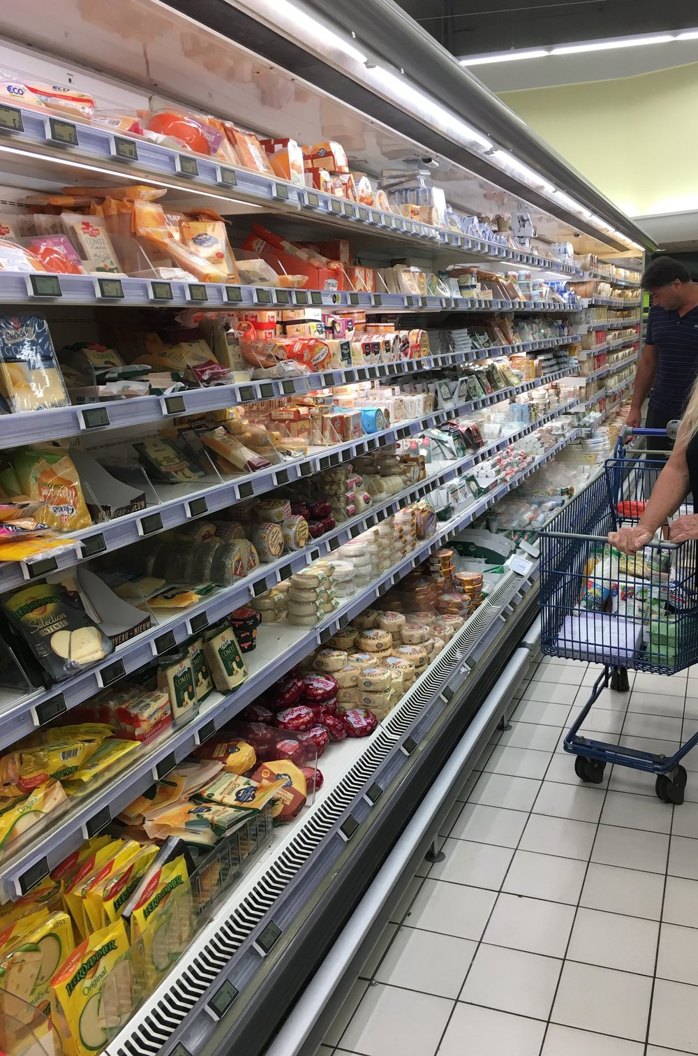 """""""Say CHEESE"""" - One of the TWO ALL cheese aisles at the E. Lecierc grocery store."""