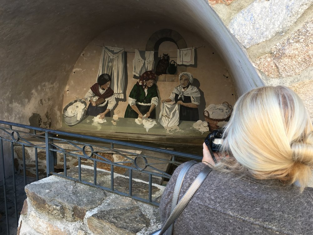 Near where we had lunch in Ramatuelle, Lainie snaps a shot of an arched cistern from a mural depicting a medieval laundry washing scene.