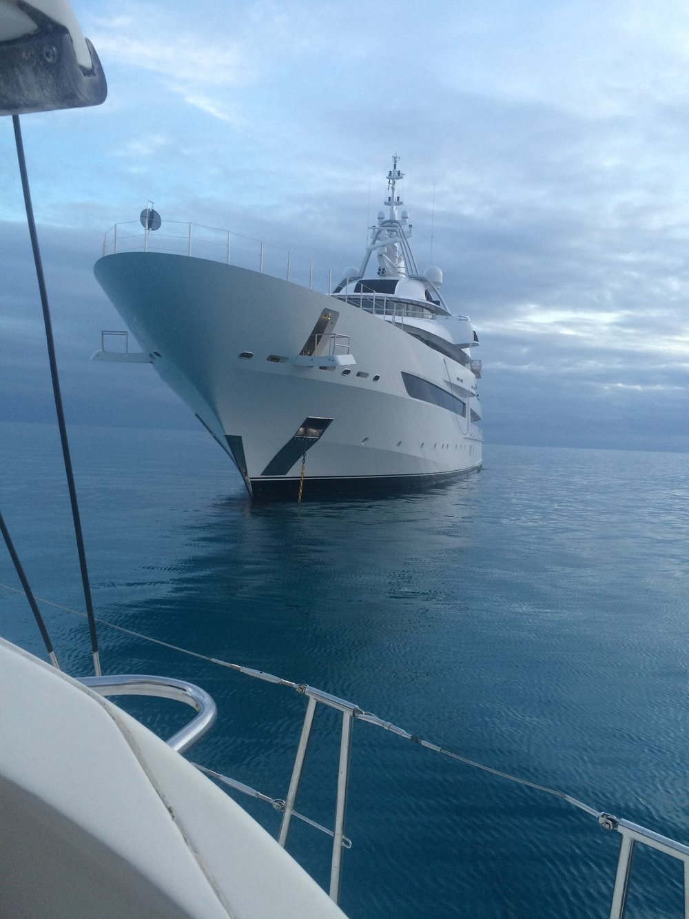A luxury yacht anchored a couple miles south of New Providence during a calm sea.