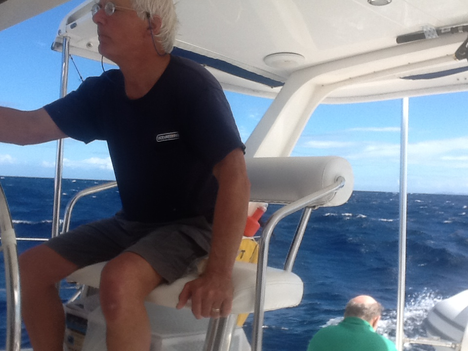 With the wind howling and we speeding along at 8-9 knots, Clint steers a broad reach course towards the Virgin Gorda and Mike prays astern for a better Thanksgiving.