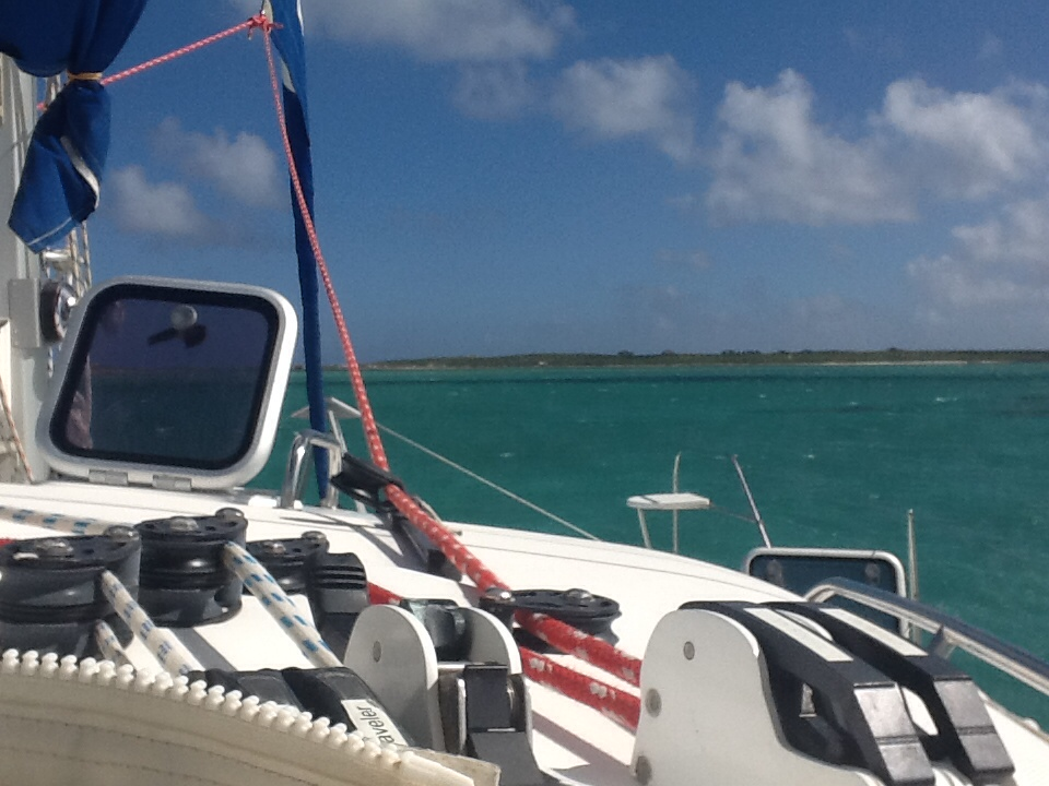 Mystique's open hatch catches the air flow as my cat approaches Great Sandy Cay on the Turks in 2015.
