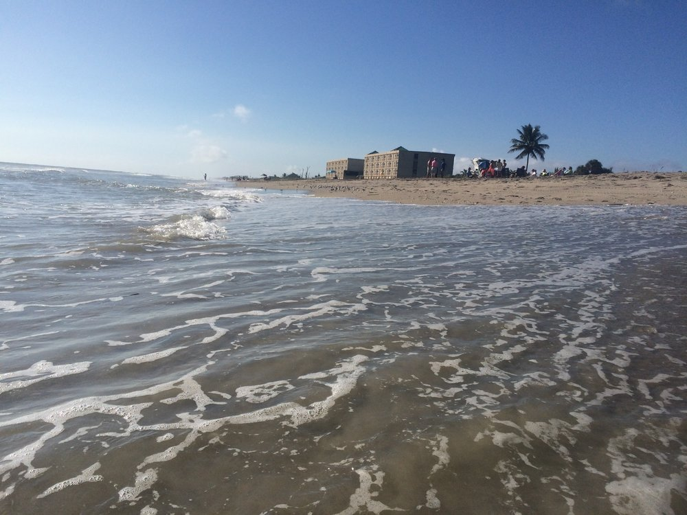 The surf flows and washes away beaches. Erosion is the result of water making inroads into land and sand. This beach nearly disappeared last year near Boca Raton.