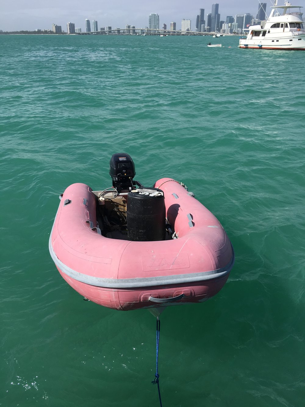 My dinghy with a tank to collect the excess fuel.