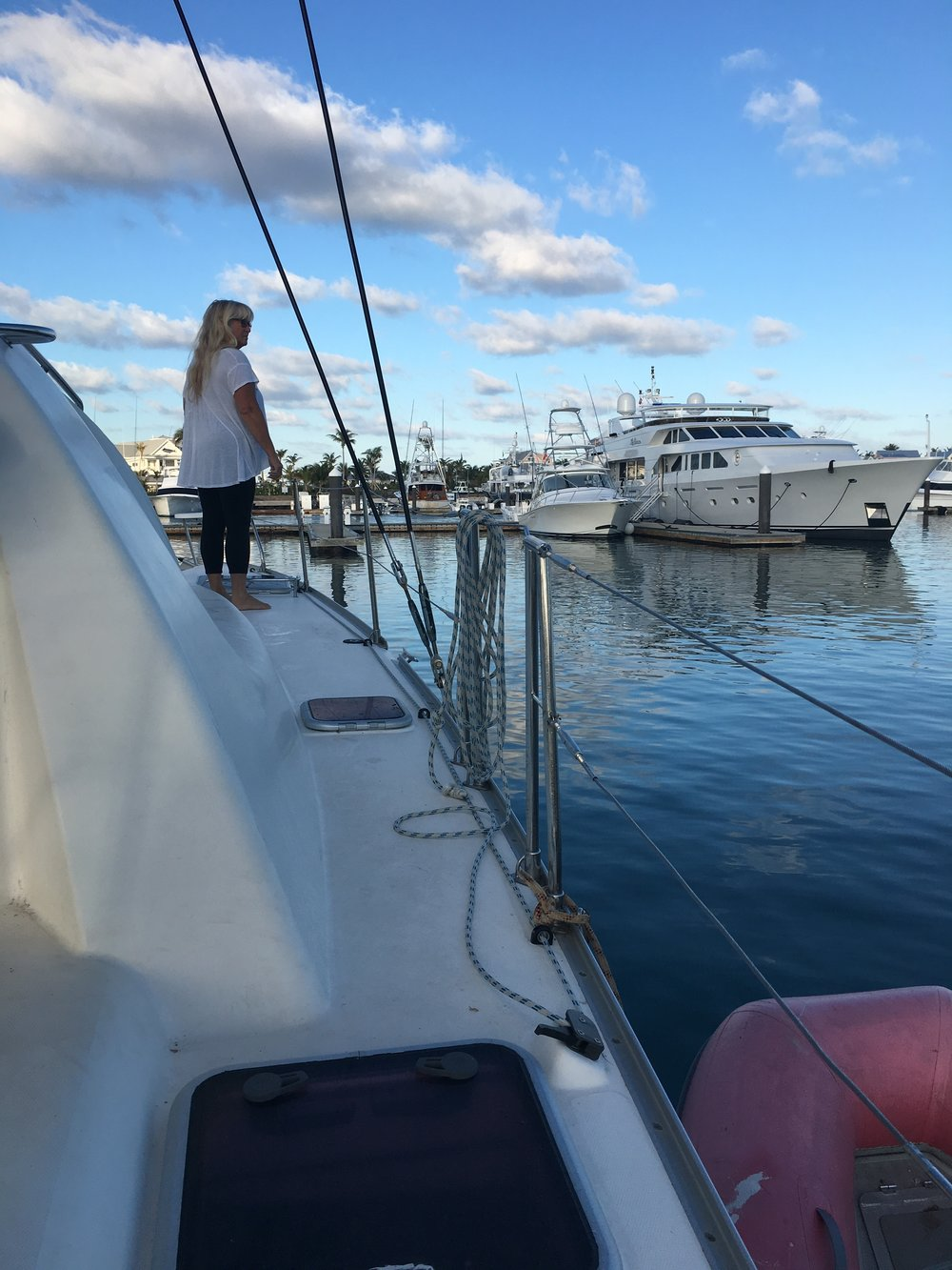 Surveying the sports fishing yachts in Chub Cay marina while  Mystique  seeks repairs.
