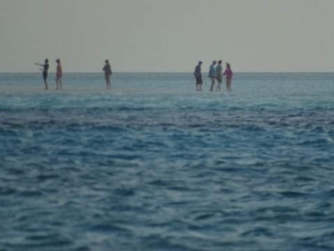 South of Spirit Cay people appeared to walk on water - optical illusion? mirage? miracle? How about a low tide on a sandbar?