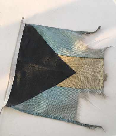 What Mystique's Bahamian flag looked like after she lost both her rudders and returned to the States.Notice how the yellow is barely frayed.