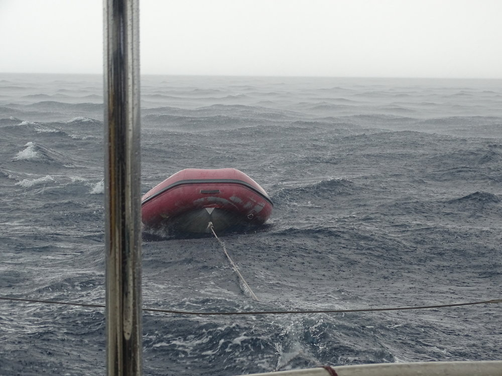 Towing dinghy through squall near Chub
