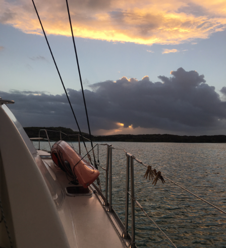 Mystique's first sunrise anchored near Lond and Spirit Cays in the northern Exumas, Bahamas. It looked like an approaching  squall from the east, but it was only a dark cloud because the sun was on the other side of it.