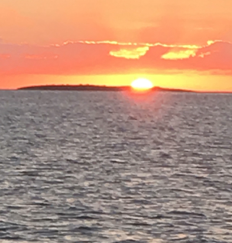 Our first sunset at West End, New Providence.  Goulding Island in the distance. Peaceful anchorage our first visit to New Providence; our second would prove  Mystique's  undoing.