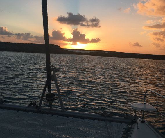 Fourth sunrise photo from  Mystique  anchored near Long Cay and Spirit Cay in the northern Exumas, Bahamas in early Feb 2018.