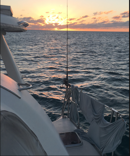 Third sunset photo from  Mystique  anchored near Long Cay and Spirit Cay in the northern Exumas, Bahamas in early Feb 2018.