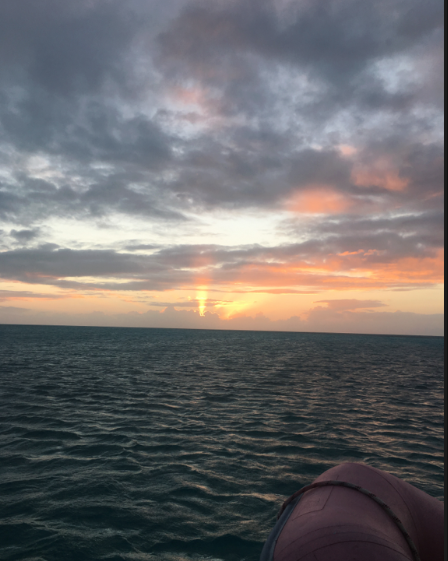 Sunset photo from  Mystique  anchored near Spirit Cay in the northern Exumas, Bahamas in early Feb 2018.
