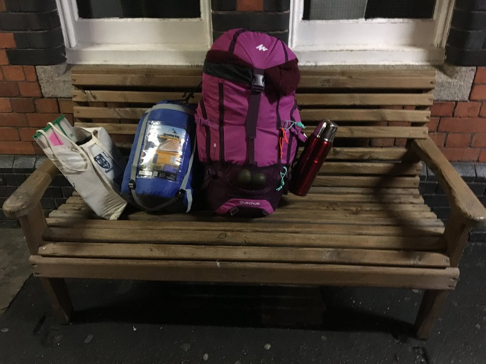 A bench outside Truro Station.  Goliath , my backpack, weighted 20 kg. The great grandfather memoirs are tucked away in that green-lined envelope. Erhm, those are limes.
