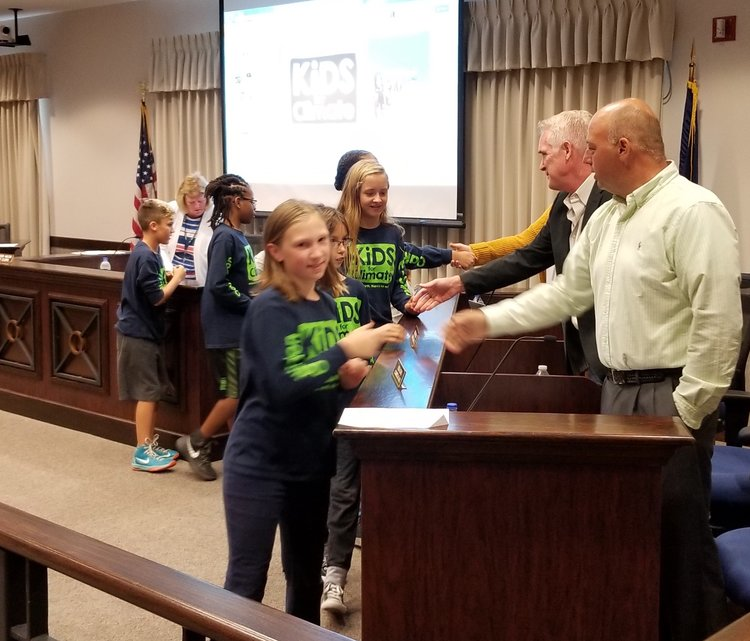 Oaklandon Kids for Climate meet Lawrence city councilors before Sept. 5 meeting.