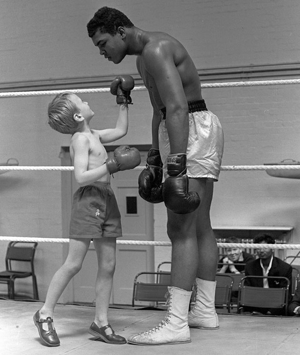 """The service you do for others is the rent you pay for your room here on Earth."" - Muhammad Ali  Muhammad Ali featured above with one of his young fans. Muhammad Ali is widely regarded as one of the most significant and celebrated sports figures of the 20th century."