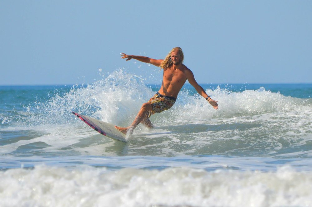 "Brandon Russell on a borrowed ""In The Pink"" by Donald Takayama, Costa Rica 2014  Photo: Siren Williams"