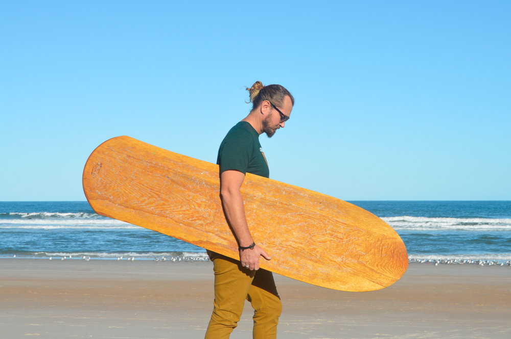 Brandon Russell with one of his self-made, hand-shaped alaias, 2017  Photo: Siren Williams